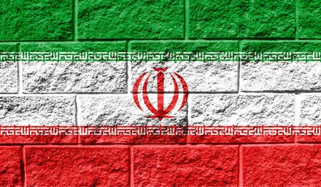 Flag of Iran close up painted on a cracked wall