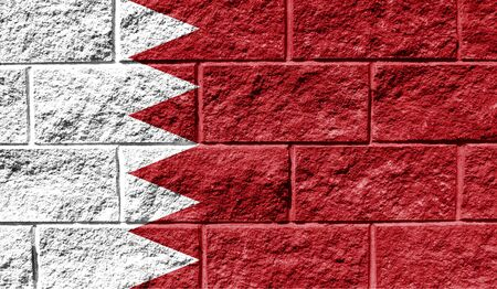 Flag of Bahrain close up painted on a cracked wall Reklamní fotografie
