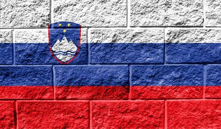 Flag of Slovenia close up painted on a cracked wall