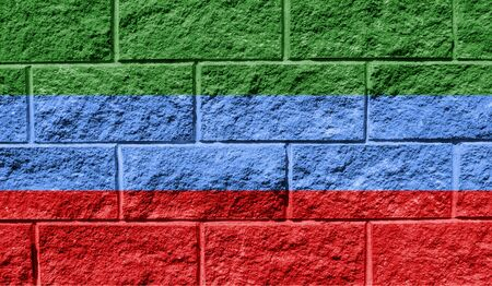 Flag of Dagestan close up painted on a cracked wall