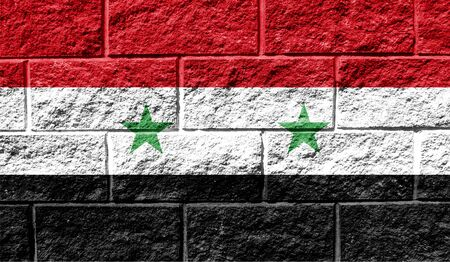 Flag of Syria close up painted on a cracked wall Reklamní fotografie