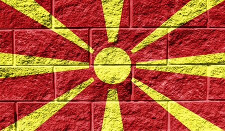 Flag of Macedonia close up painted on a cracked wall