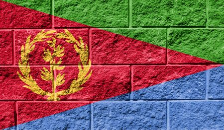 Flag of Eritrea close up painted on a cracked wall