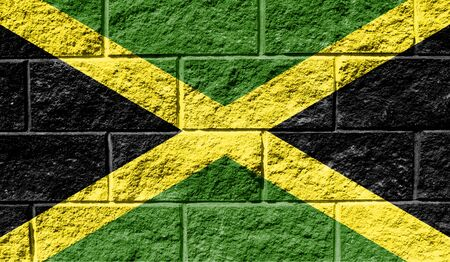 Flag of Jamaica close up painted on a cracked wall Reklamní fotografie