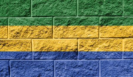Flag of Gabon close up painted on a cracked wall