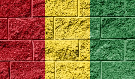 Flag of Guinea close up painted on a cracked wall