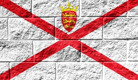 Flag of Jersey close up painted on a cracked wall