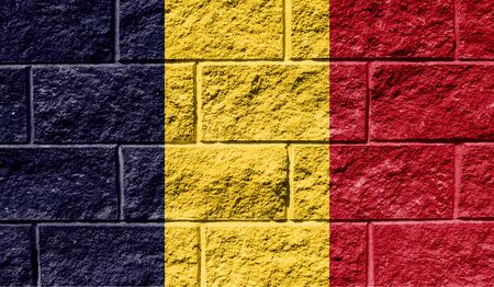 Flag of Chad close up painted on a cracked wall
