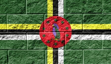 Flag of Dominica close up painted on a cracked wall