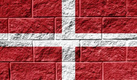 Flag of Sovereign Military Order of Malta close up painted on a cracked wall 스톡 콘텐츠
