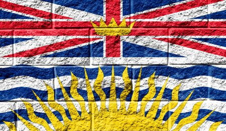 Flag of British Columbia close up painted on a cracked wall
