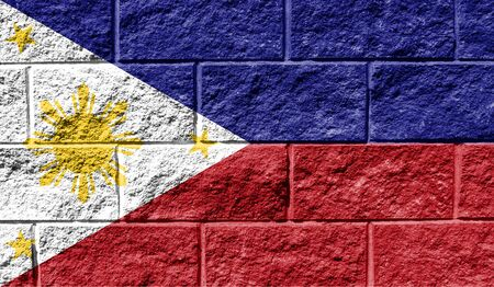 Flag of Philippines close up painted on a cracked wall