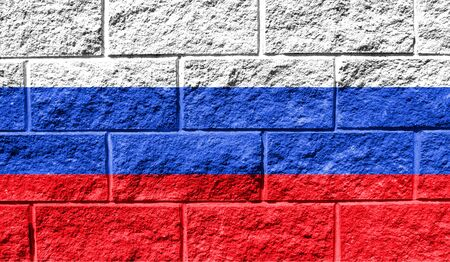 Flag of Russia close up painted on a cracked wall Reklamní fotografie