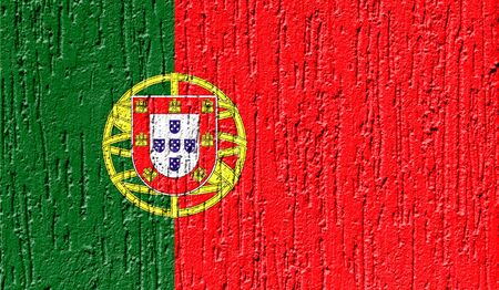 Flag of Portugal close up painted on a cracked wall