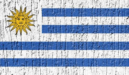 Flag of Uruguay close up painted on a cracked wall Stock Photo