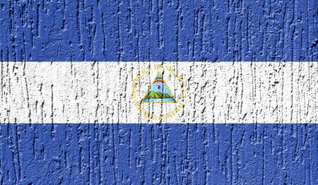 Flag of Nicaragua close up painted on a cracked wall