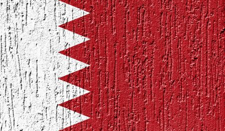 Flag of Bahrain close up painted on a cracked wall Stock Photo
