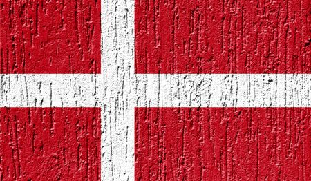 Flag of Denmark close up painted on a cracked wall