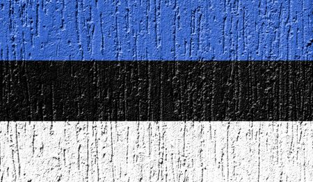 Flag of Estonia close up painted on a cracked wall