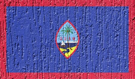 Flag of Guam close up painted on a cracked wall