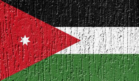 Flag of Jordan close up painted on a cracked wall