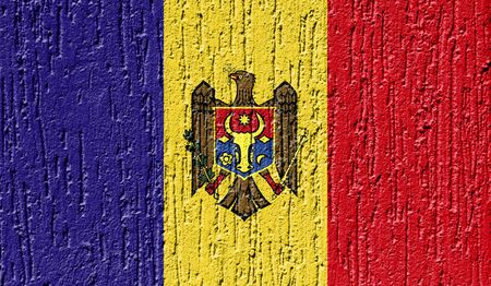 Flag of Moldova close up painted on a cracked wall Stock Photo
