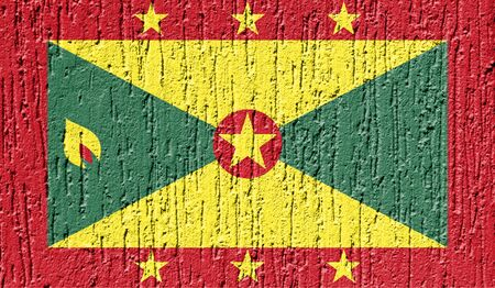 Flag of Grenada close up painted on a cracked wall