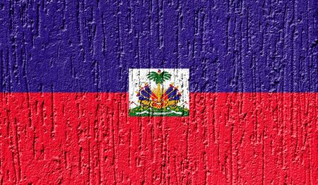 Flag of Haiti close up painted on a cracked wall