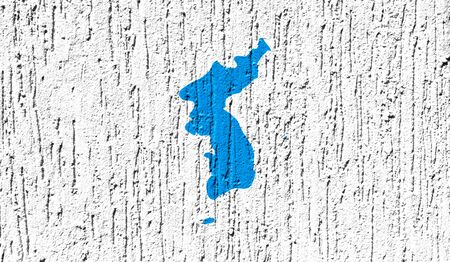 Flag of Korean Unification close up painted on a cracked wall Фото со стока