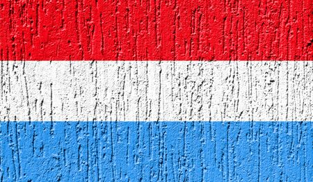 Flag of Luxembourg close up painted on a cracked wall