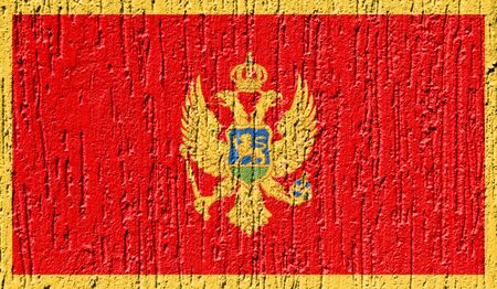 Flag of Montenegro close up painted on a cracked wall