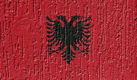 Flag of Albania close up painted on a cracked wall