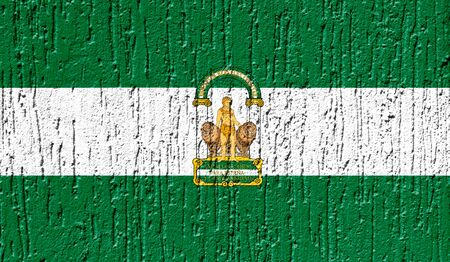Flag of Andalusia close up painted on a cracked wall