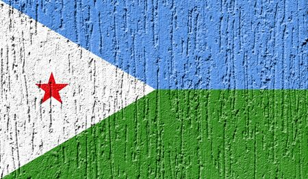 Flag of Djibouti close up painted on a cracked wall