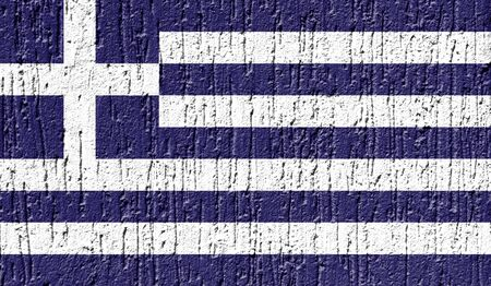Flag of Greece close up painted on a cracked wall Фото со стока