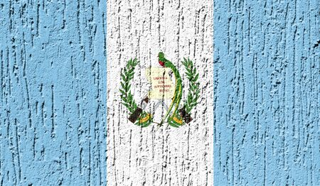 Flag of Guatemala close up painted on a cracked wall