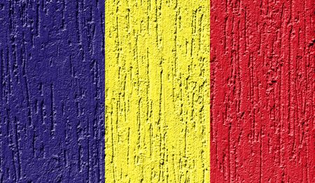 Flag of Romania close up painted on a cracked wall
