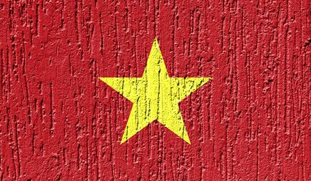 Flag of Vietnam close up painted on a cracked wall
