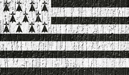 Flag of Brittany close up painted on a cracked wall