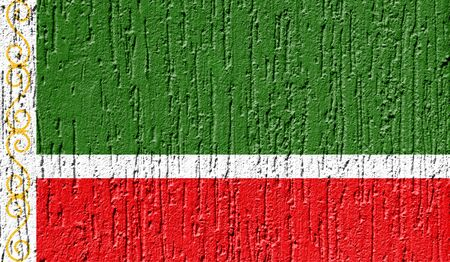 Flag of Chechen Republic close up painted on a cracked wall