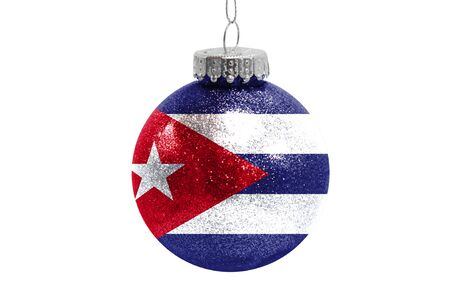 Glass Christmas ball toy isolated on white background with the flag of Cuba