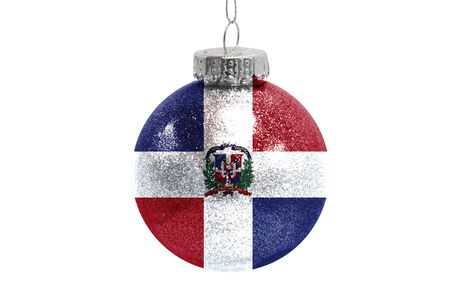 Glass Christmas ball toy isolated on white background with the flag of Dominican Republic