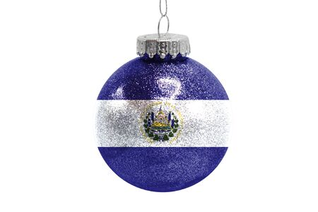Glass Christmas ball toy isolated on white background with the flag of El Salvador Фото со стока