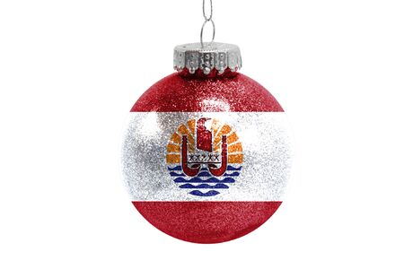 Glass Christmas ball toy isolated on white background with the flag of French Polynesia Фото со стока