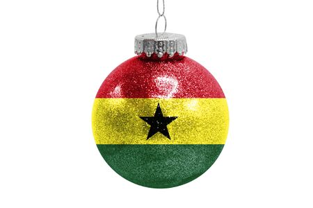 Glass Christmas ball toy isolated on white background with the flag of Ghana