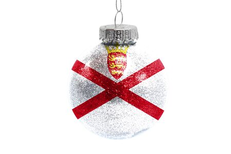 Glass Christmas ball toy isolated on white background with the flag of Jersey