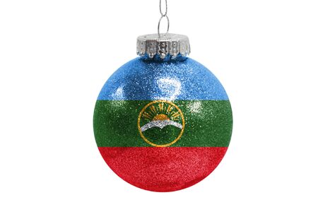 Glass Christmas ball toy isolated on white background with the flag of Karachay Cherkessia