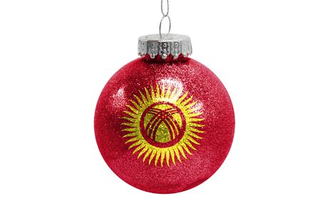 Glass Christmas ball toy isolated on white background with the flag of Kyrgyzstan