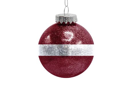 Glass Christmas ball toy isolated on white background with the flag of Latvia Фото со стока