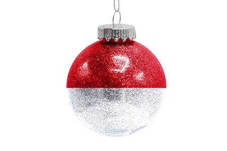 Glass Christmas ball toy isolated on white background with the flag of Monaco